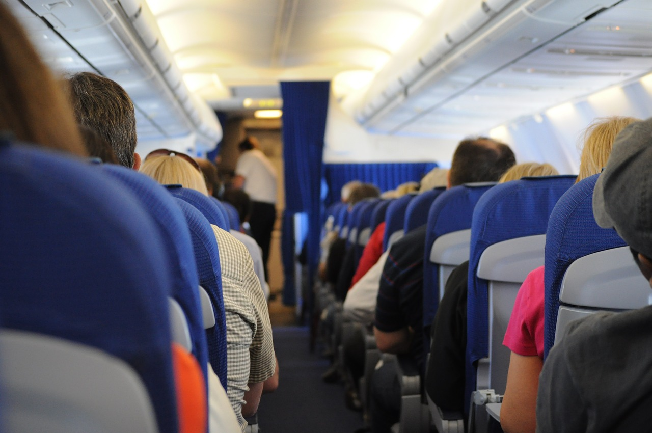 airplane,on board,seats,people,travel,transportation,aisle,free pictures, free photos, free images, royalty free, free illustrations, public domain