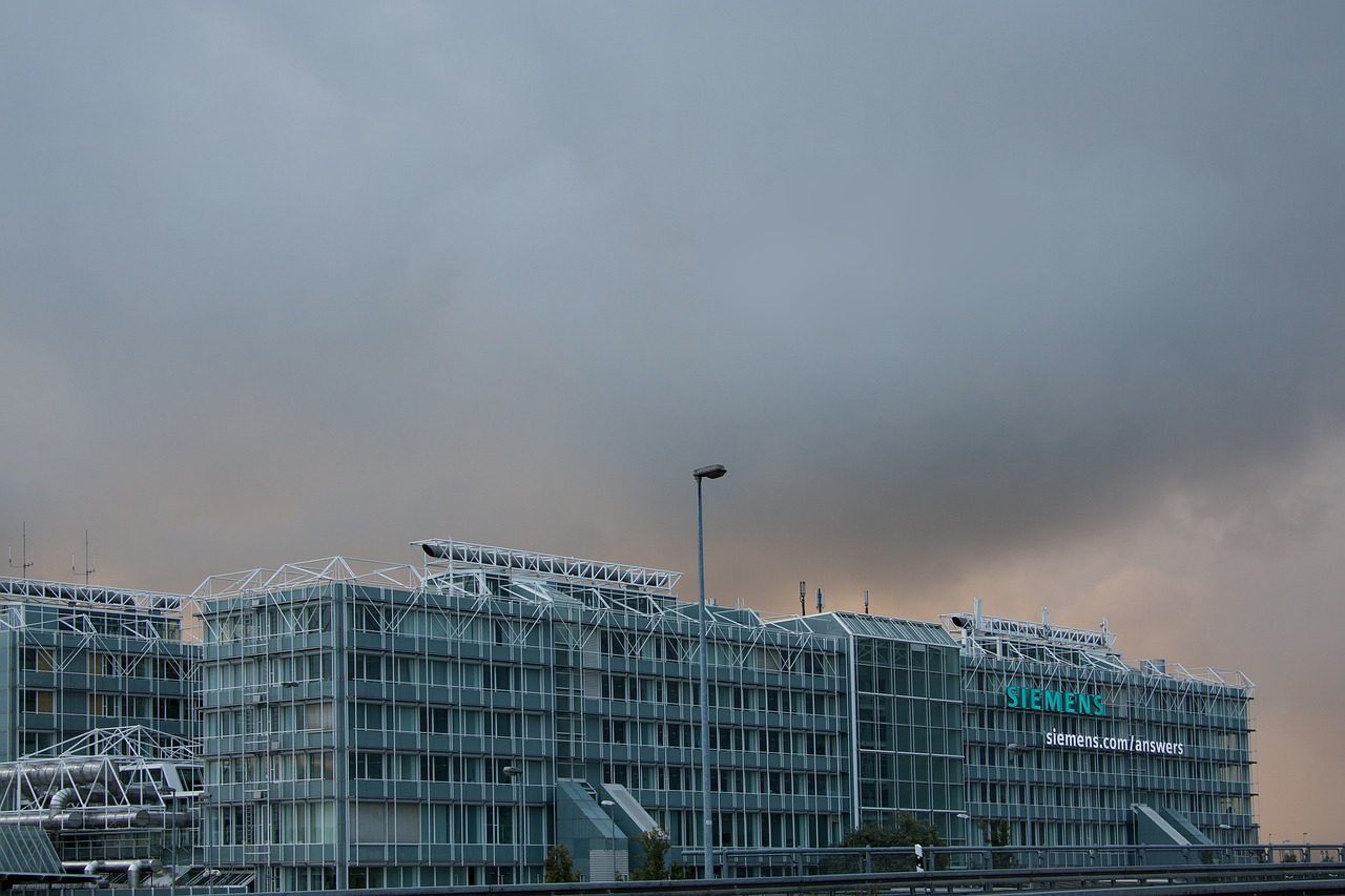 airport,international,munich,architecture,building,transport,siemens,industrial construction,functional,concrete,steel,glass,sky,rain,orange,grey,free pictures, free photos, free images, royalty free, free illustrations, public domain