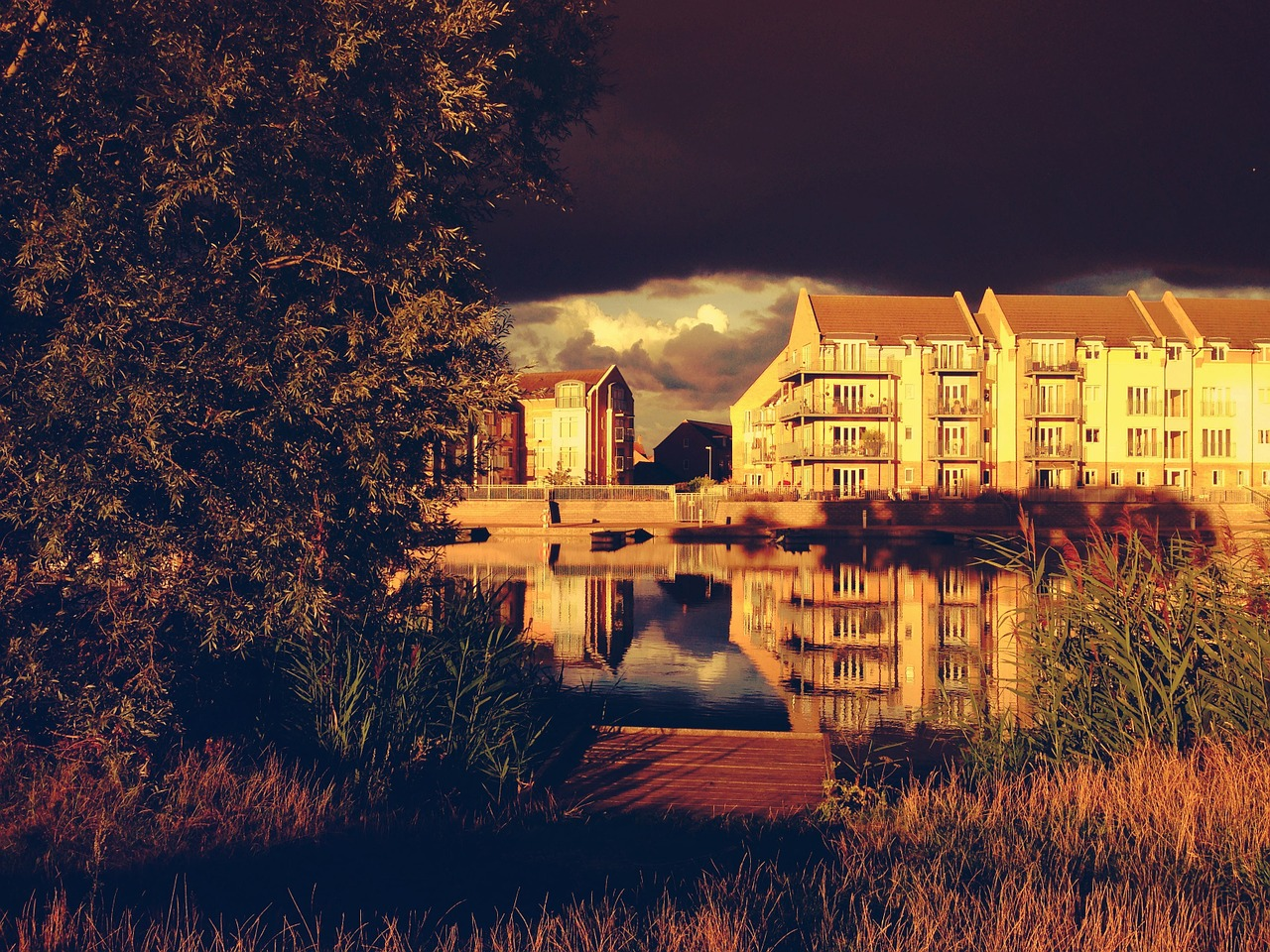 apartment building lake reflection free photo