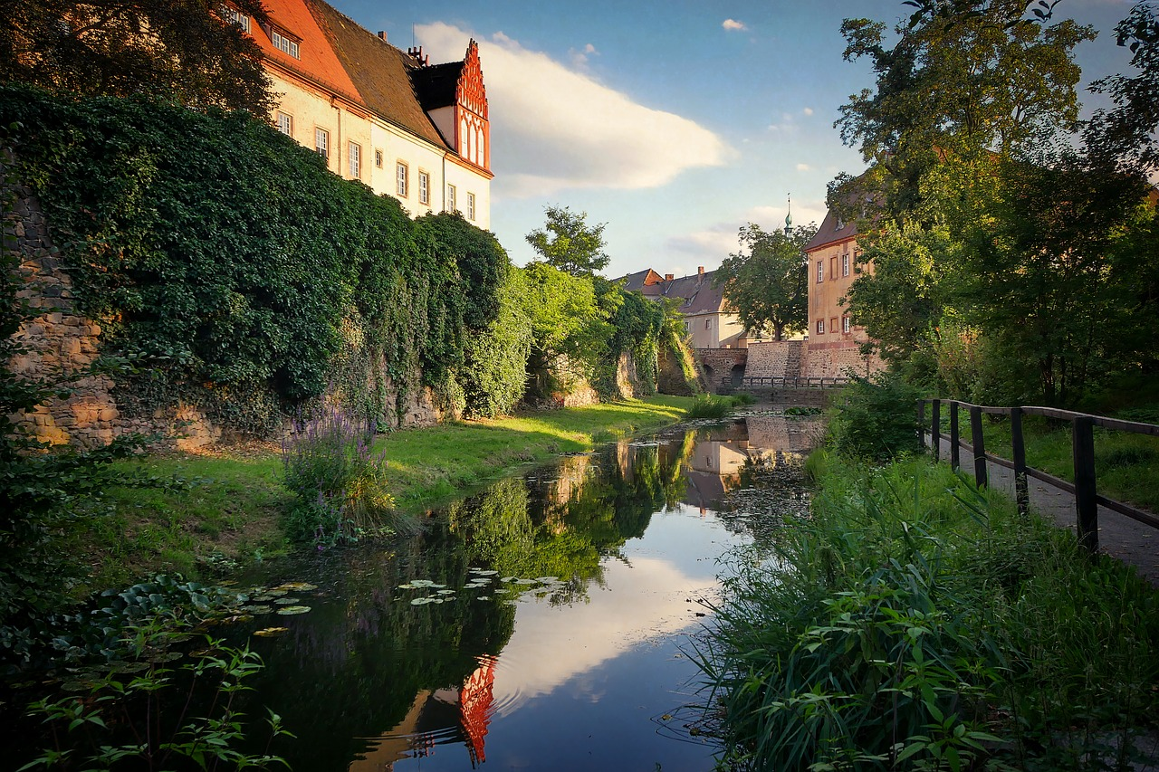architecture,travel,waters,tree,river,old,sky,home,castle,building,moat,water,mirroring,fairy castle,romantic,idyllic,free pictures, free photos, free images, royalty free, free illustrations, public domain