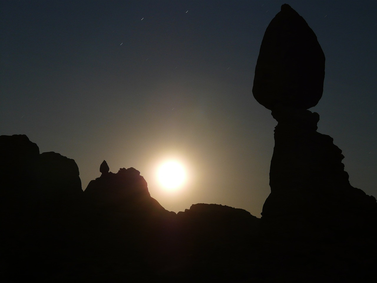 balanced rock night moonlight free photo