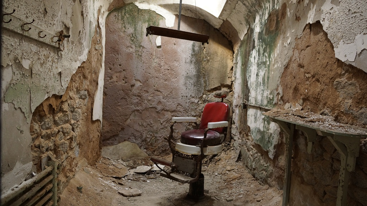 barber shop,chair,barber,salon,male,prison,forgotten places,ruin,cell,jail,old,penitentiary,historic,derelict,history,free pictures, free photos, free images, royalty free, free illustrations, public domain