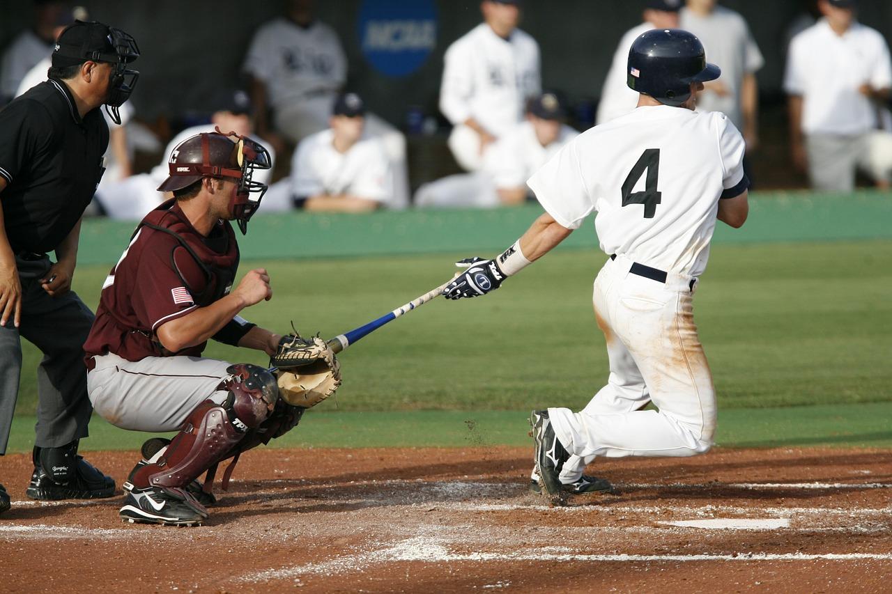 Baseball players swinging the bat