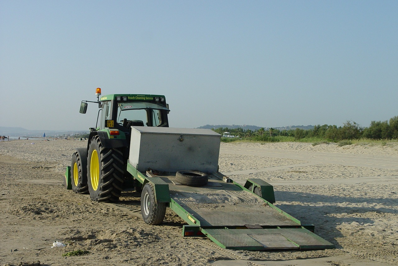 beach tractor cleaning beaches free photo