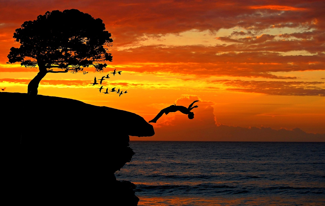 boy,cliff,jump,courage,sea,klipp springer,sport,leisure,pike jump,plunge,swim,body,sunset,rock,overcoming,sporty,venture,high,landscape,coast,water,nature,ocean,sky colors,sky,tree,holiday,summer,evening sky,silhouette,back light,composing,digiart,free pictures, free photos, free images, royalty free, free illustrations, public domain