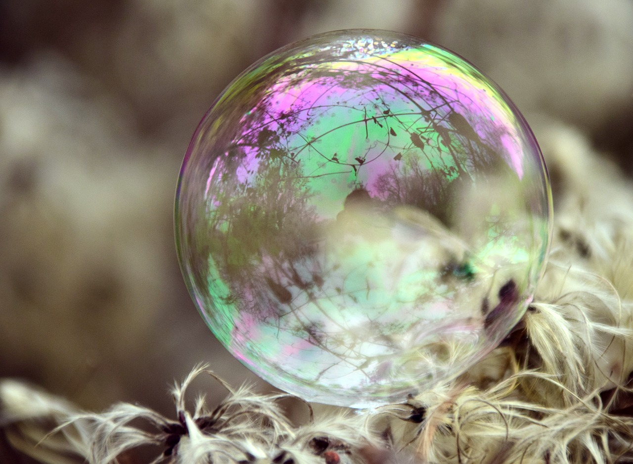 bubble,soap bubble,iridescent,colorful,ease,ball,reflection,depend,close,transparent,mirroring,beautiful,free pictures, free photos, free images, royalty free, free illustrations, public domain