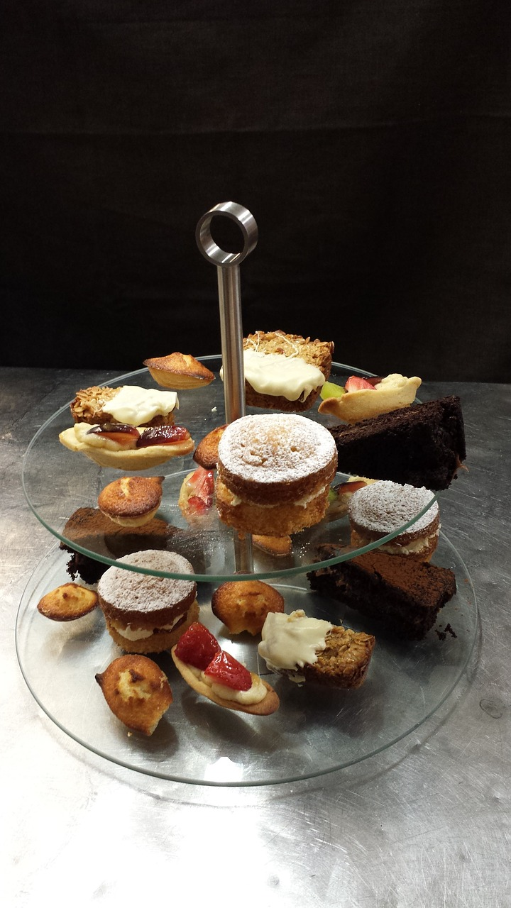 cakes cakes on stand afternoon tea free photo