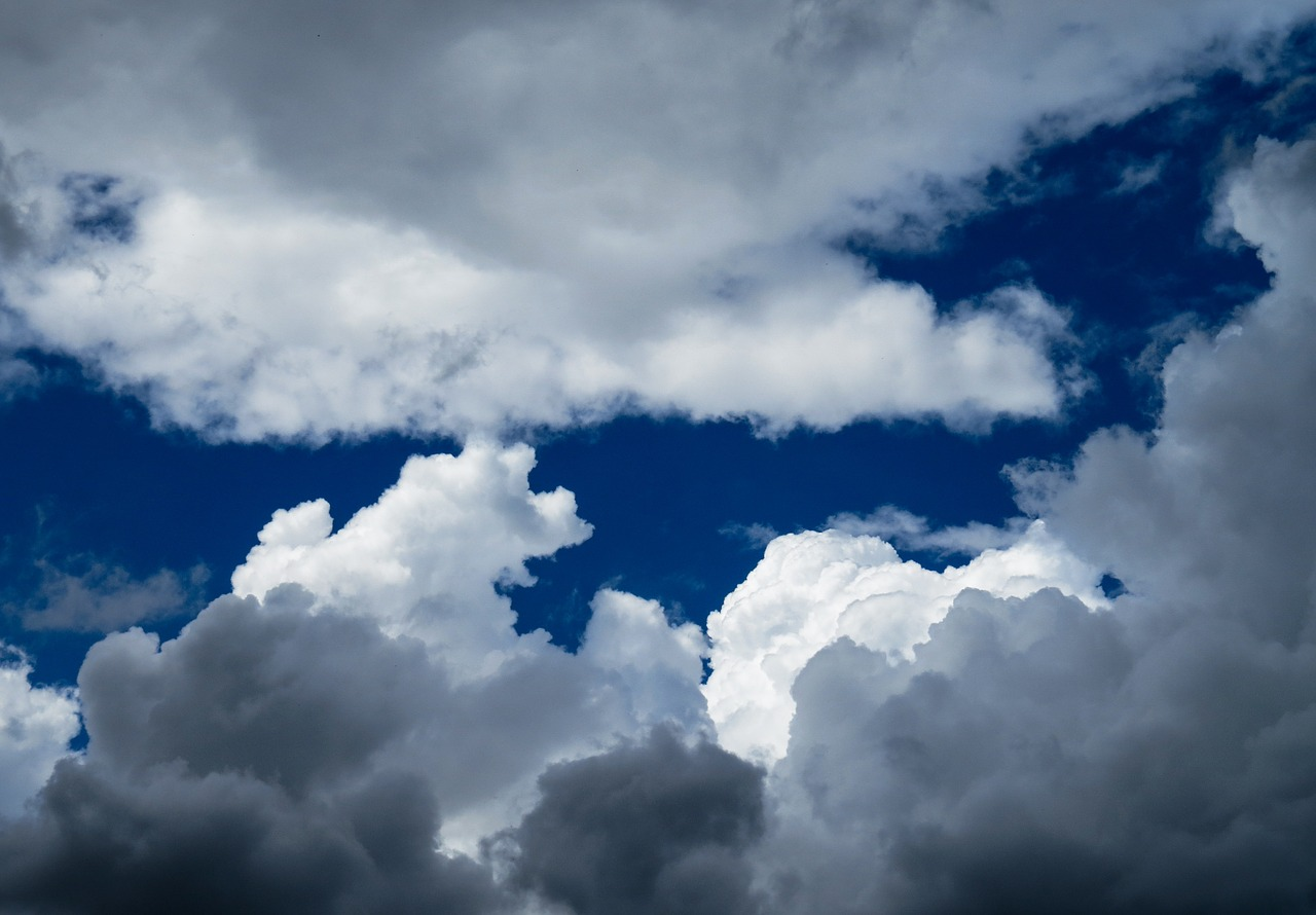 clouds,sky,clouds form,dark clouds,above the clouds,blue,flight,view,fly,storm clouds,mood,nature,free pictures, free photos, free images, royalty free, free illustrations, public domain