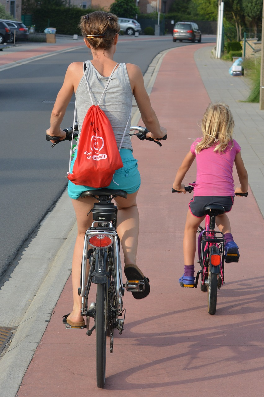 cyclists,people,backpack,guidance,mother and child,child,woman,bicycle,sportive,sports,traffic,traffic situation,bike path,cycling,road safety education,education,free pictures, free photos, free images, royalty free, free illustrations, public domain