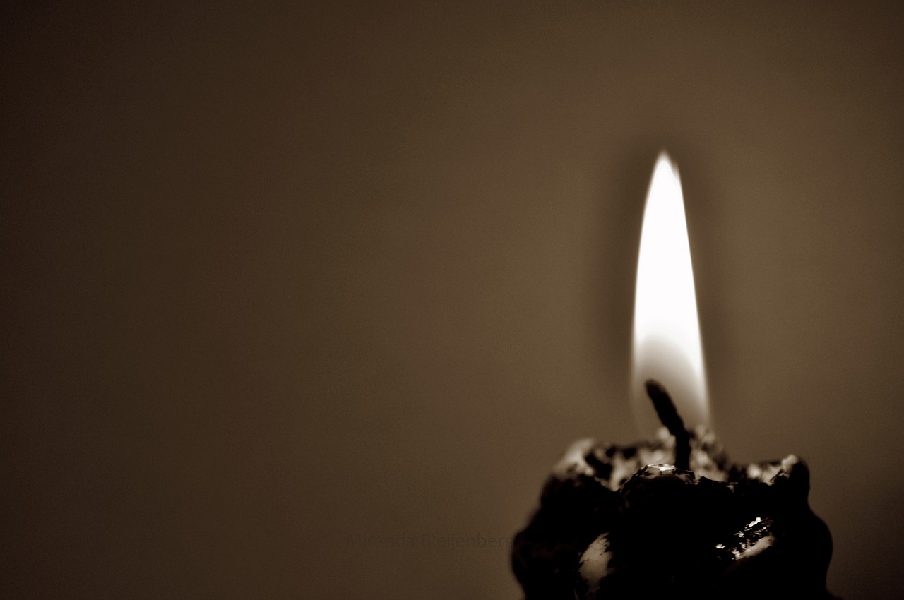 flamecandlechristmaslightsepiaburningcandlelightromantic