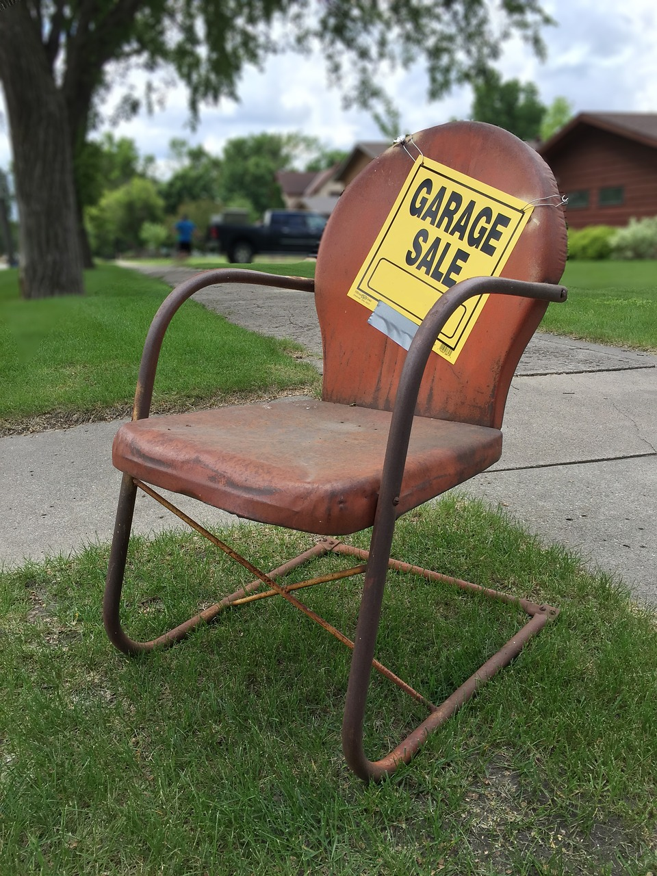 Garage sale sign,rusty,rusty metal chair,vintage,old lawn chair