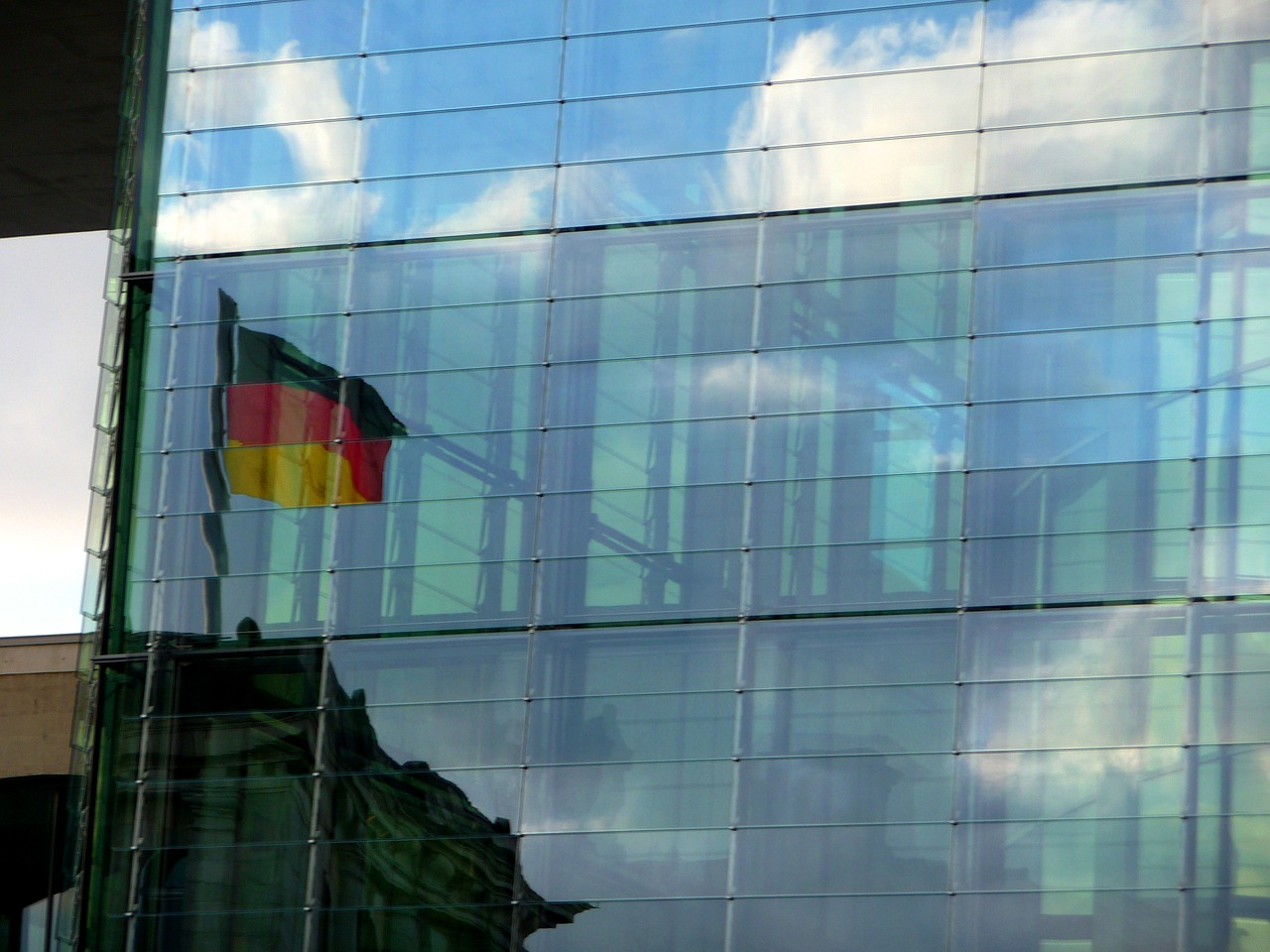 germany flag,flag,mirroring,facade,building,architecture,germany,black red gold,background,german flag,home,national colours,national flag,symbol,free pictures, free photos, free images, royalty free, free illustrations, public domain