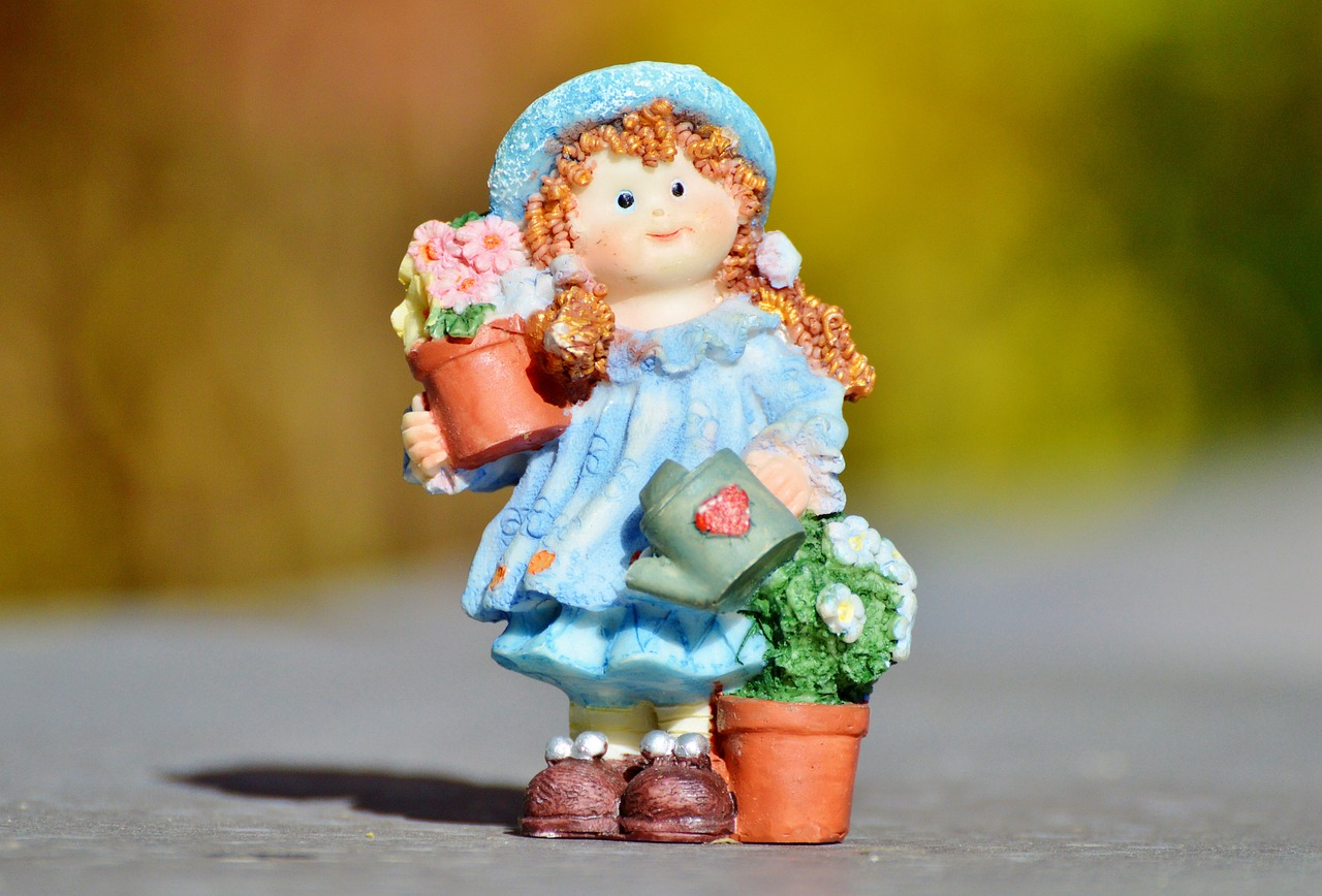 girl doll gardener free photo