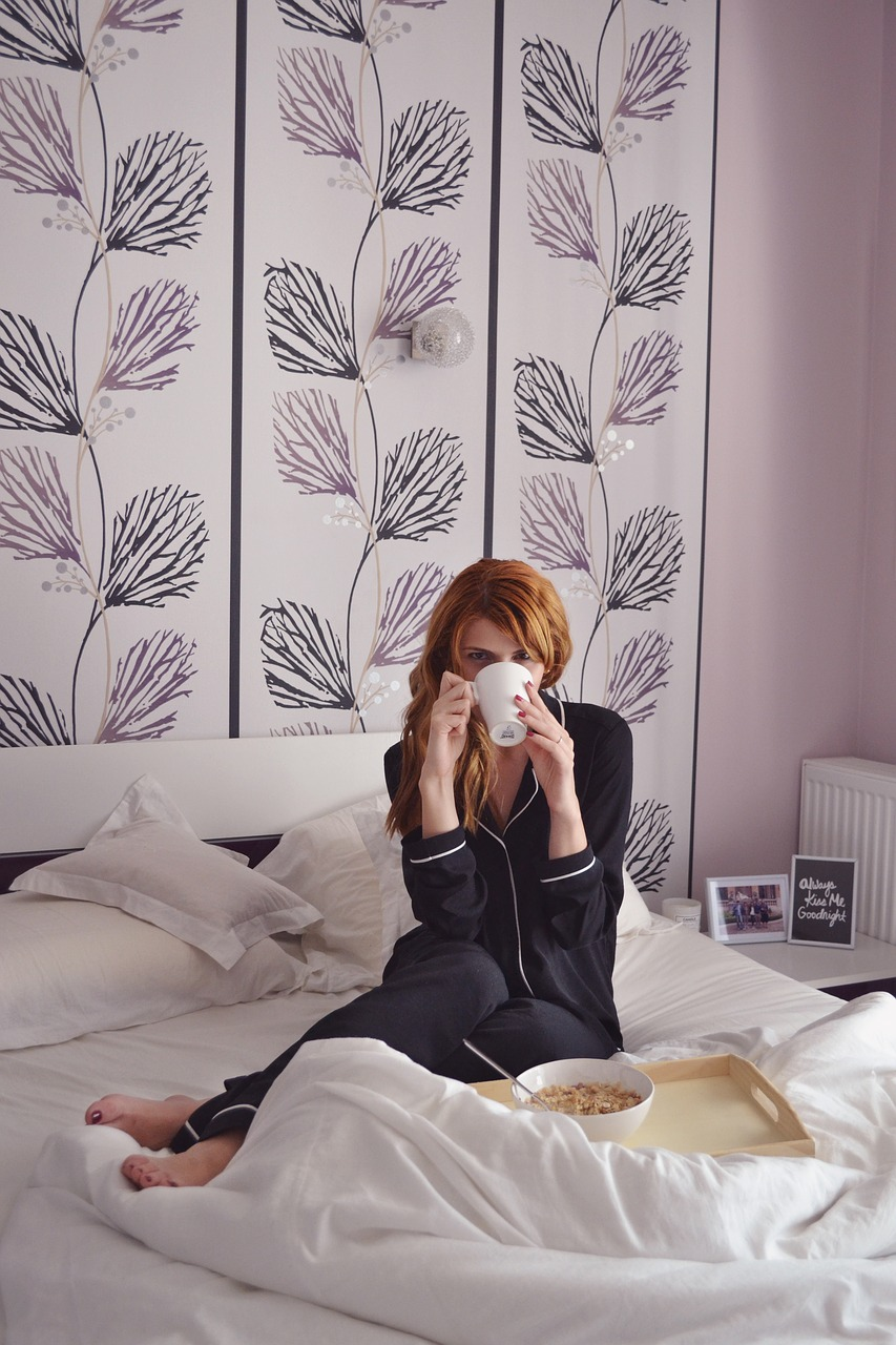 girl in bed breakfast in bed girl with coffee cup free photo