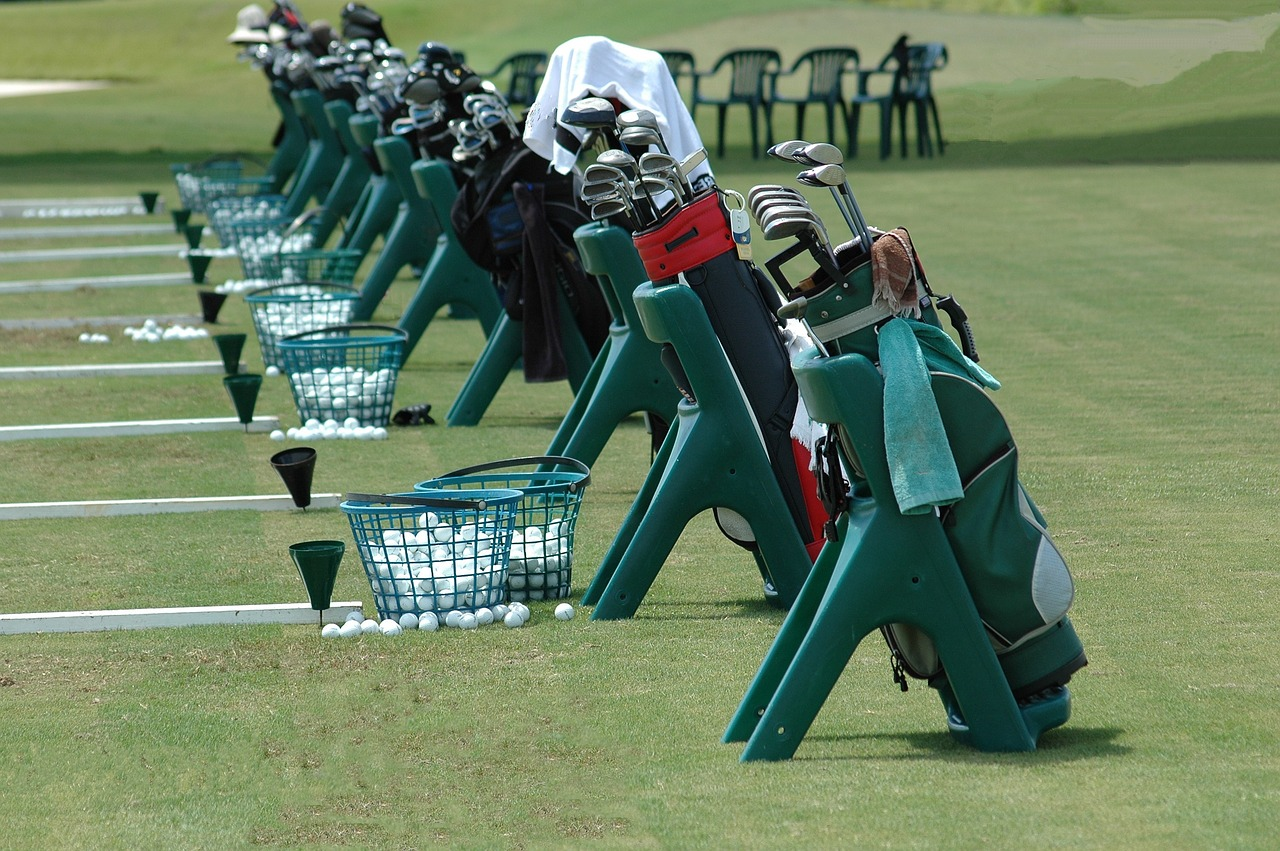 golf clubs golf bags driving range free photo