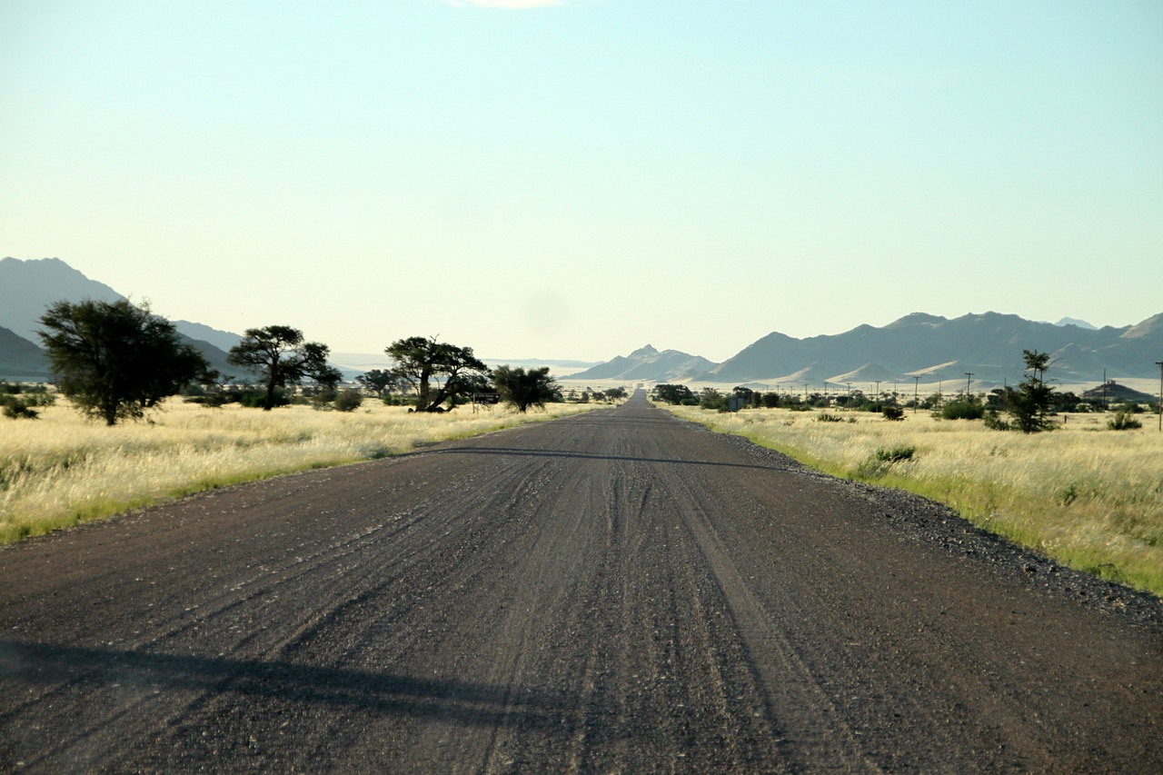 gravel road dirt road lonely free photo