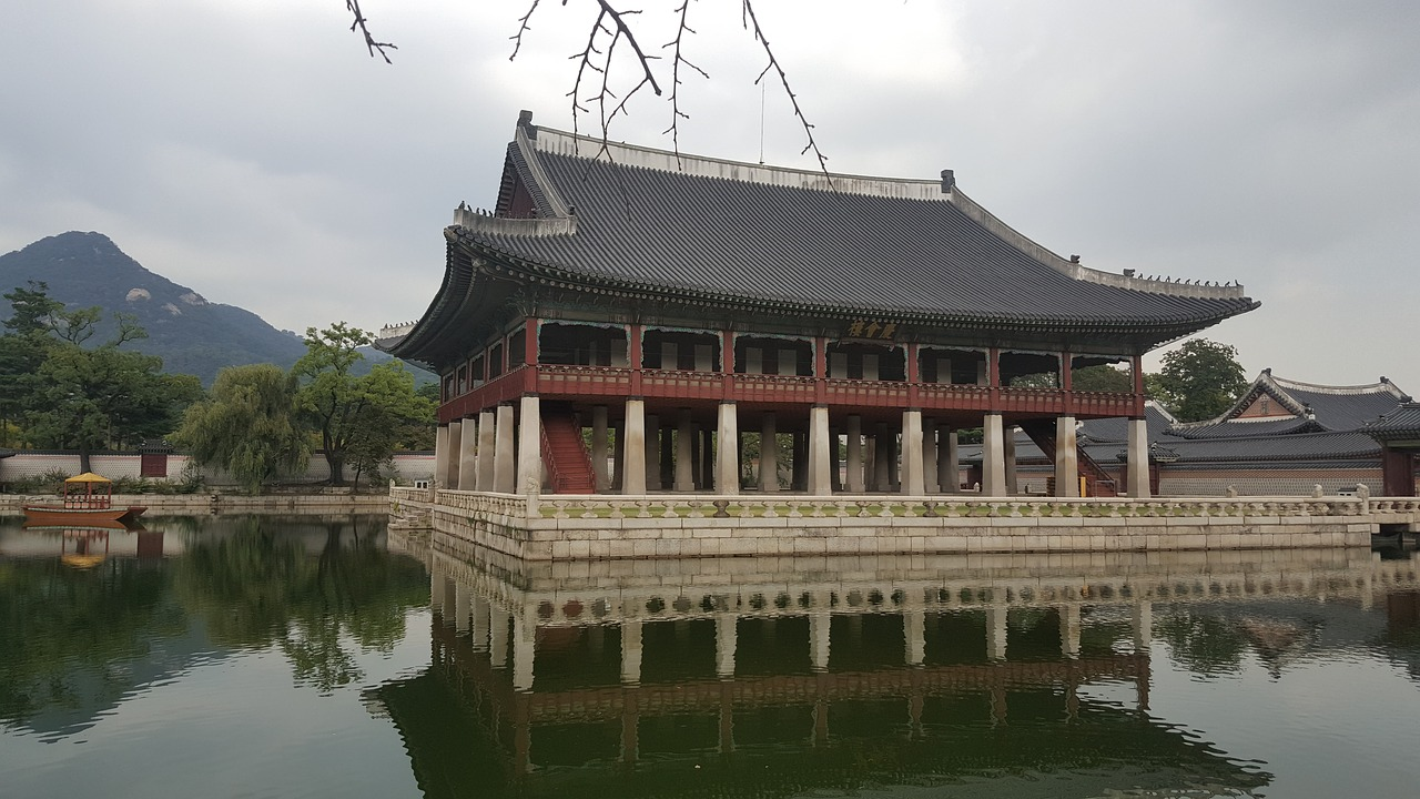 gyeongbok palace the palace in the background the pond in the background free photo