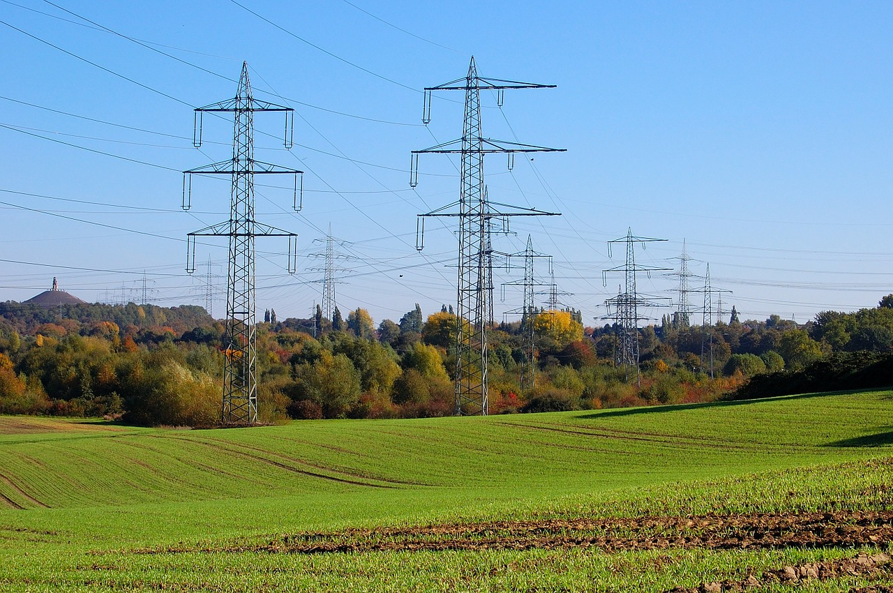 high-voltage pylons power poles field free photo