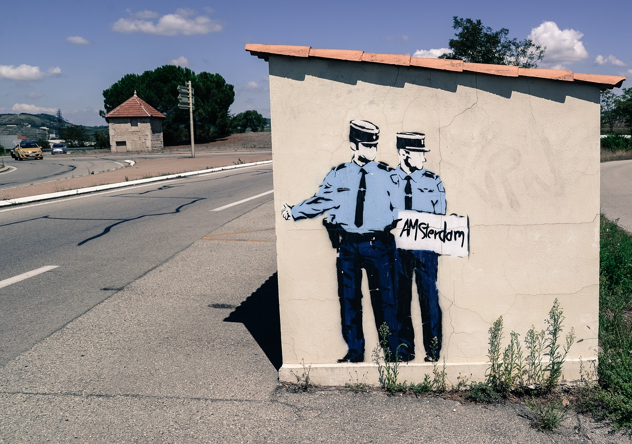 hitchhiking,cops,mural,paint,art,street,uniform,bus stop,grafitti,free pictures, free photos, free images, royalty free, free illustrations