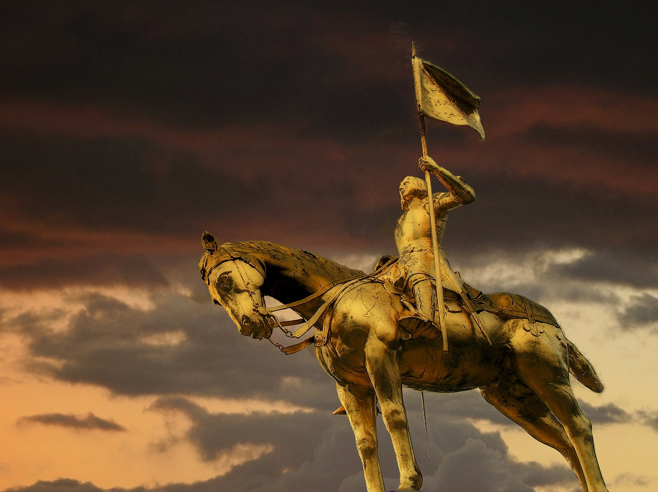 joan of arc golden sculpture free photo