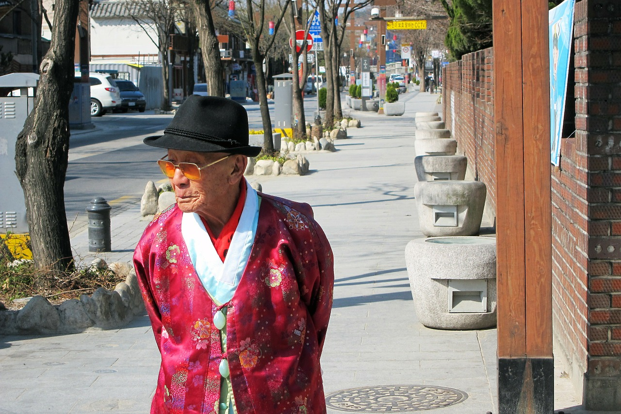 korea,street,morning,seoul,old man,hat,red,walking,stroll,free pictures, free photos, free images, royalty free, free illustrations, public domain