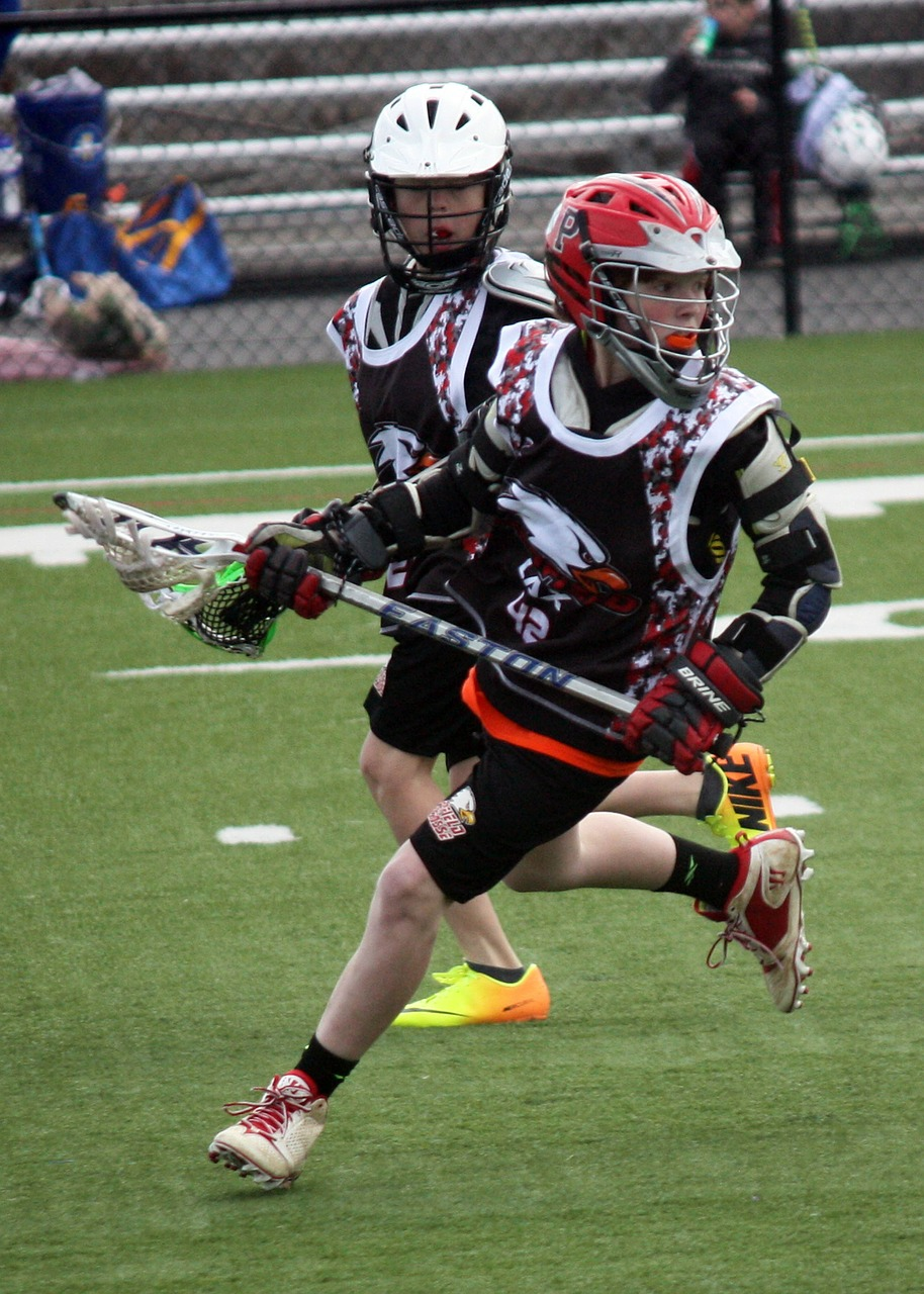 lacrosse player running free photo