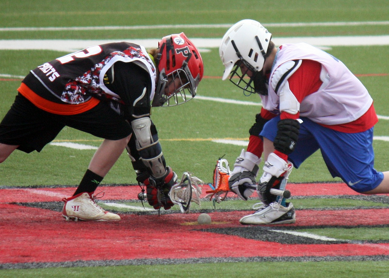 lacrosse player face-off free photo