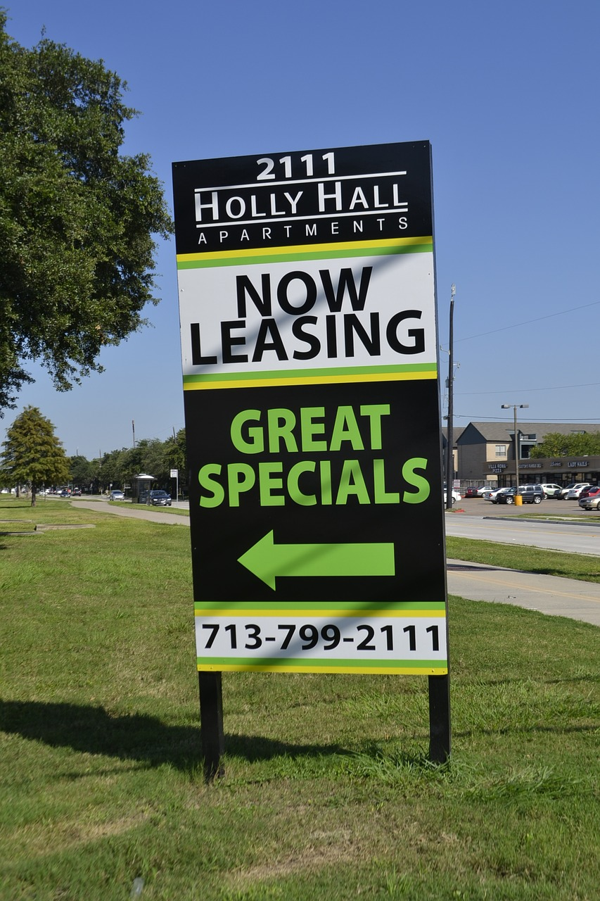 Now Leasing sign for an apartment complex