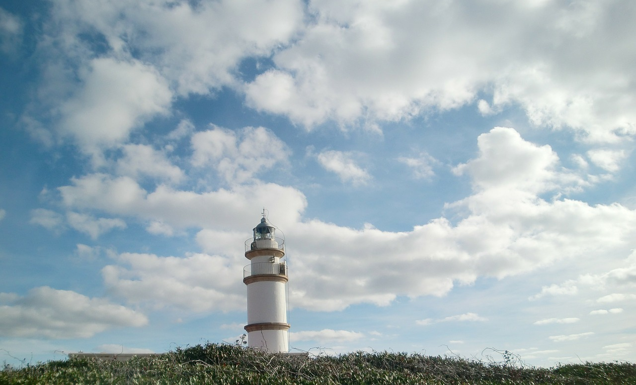 lighthouse sky clouds free photo
