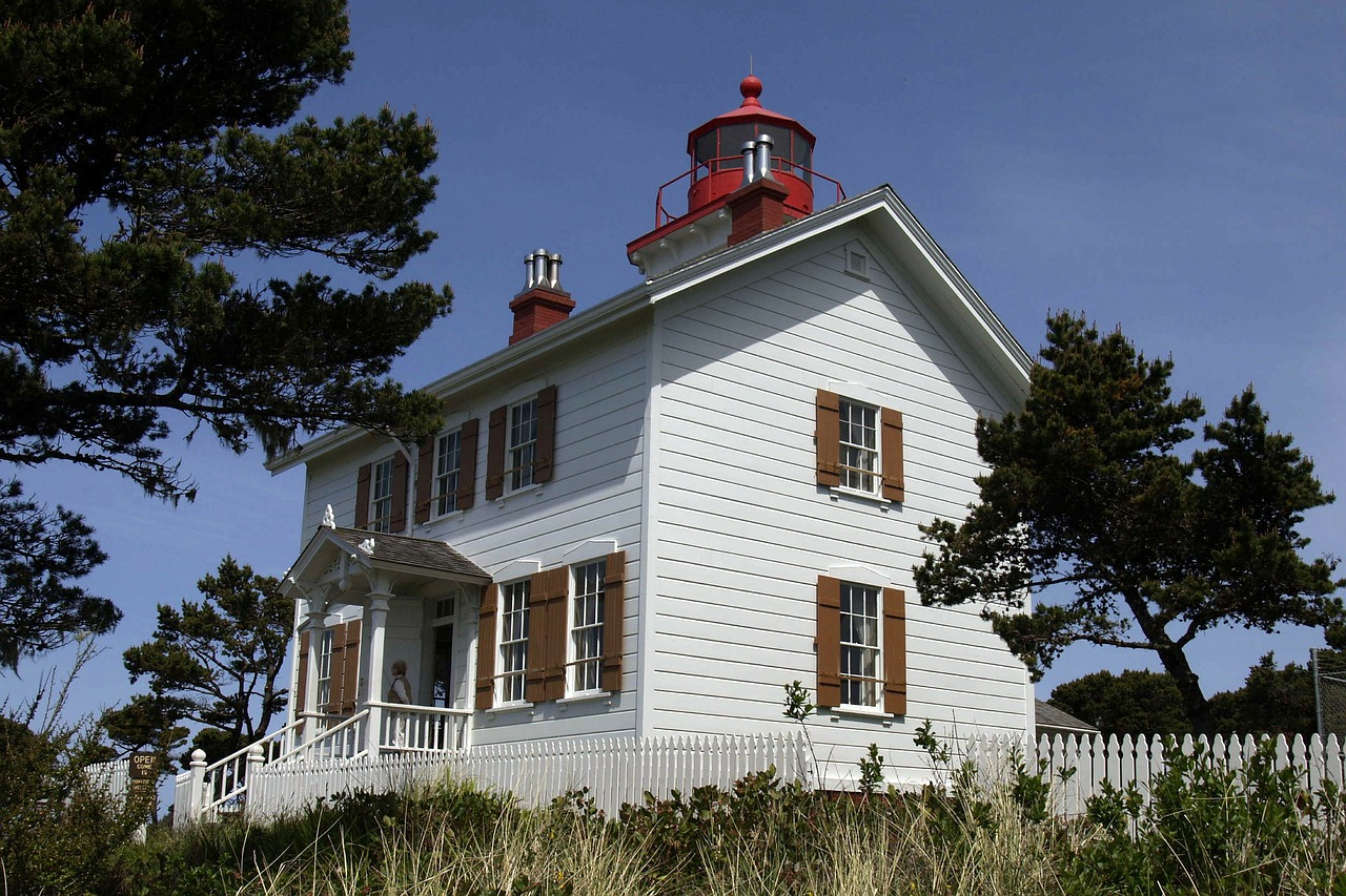 lighthouse building coast free photo