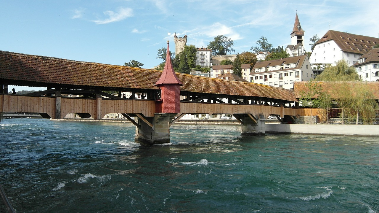 lucerne,spreuer bridge,bridge,water,mus harrows tower,musegg wall,reuss,river,blue,switzerland,free pictures, free photos, free images, royalty free, free illustrations, public domain