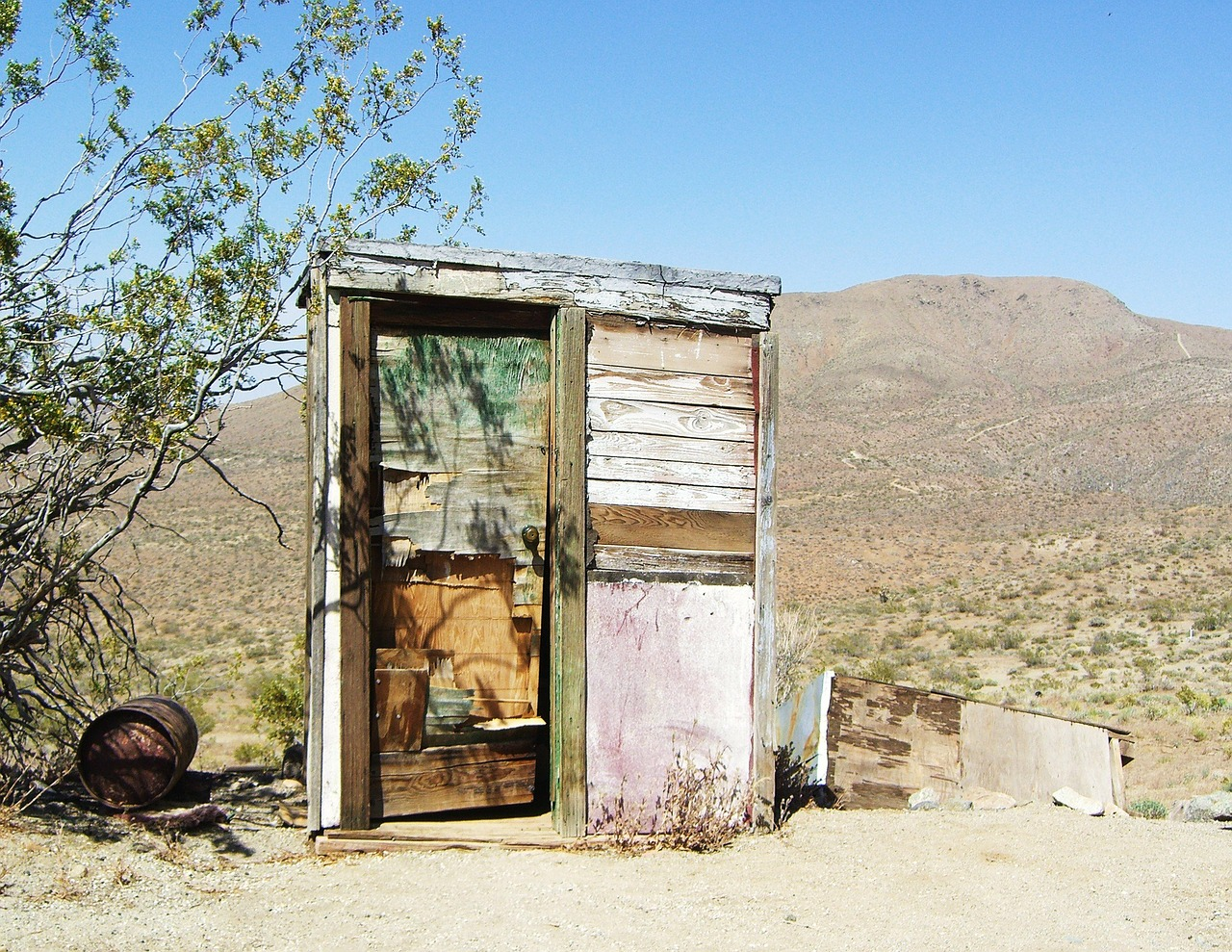 mojave desert,outhouse,dilapidated,disrepair,bathroom,toilet,restroom,deserted,run down,fixer upper,california,ghost town,free pictures, free photos, free images, royalty free, free illustrations, public domain