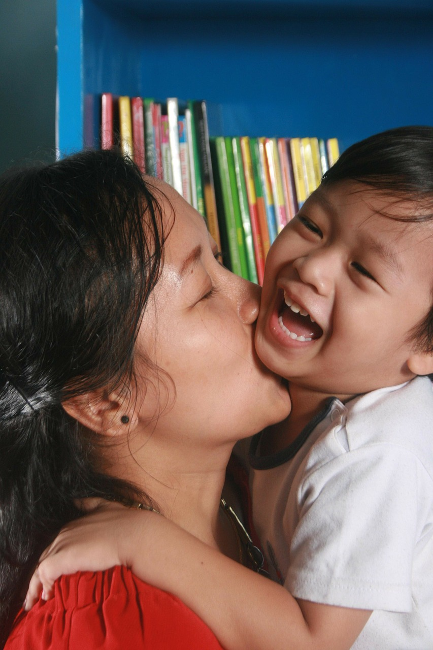 mother son kiss free photo