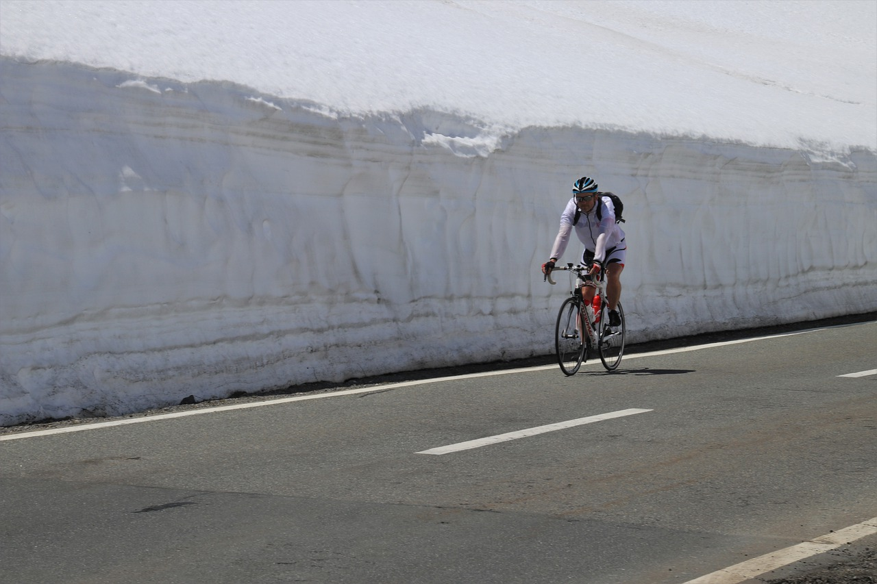 mountain  cyclist  snow free photo
