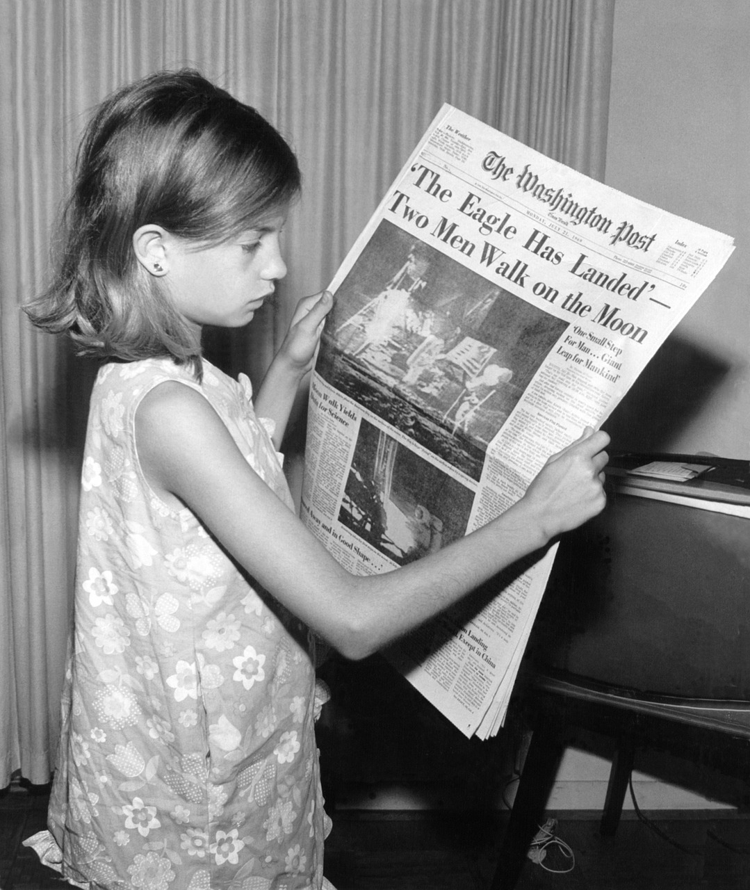 newspaper,news,read,moon landing,child,21 july 1969,usa,washington post,black and white,free pictures, free photos, free images, royalty free, free illustrations, public domain