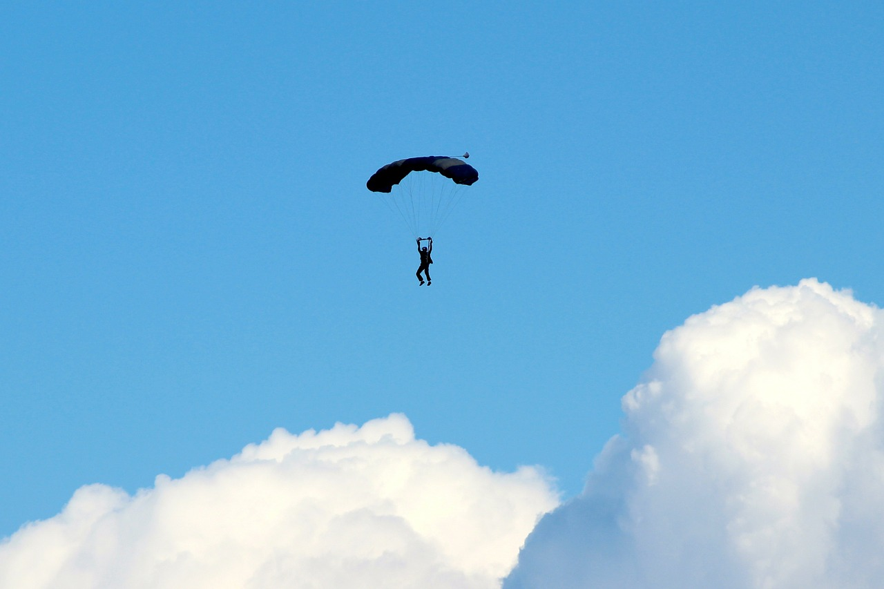 parachute parasailing clouds free photo