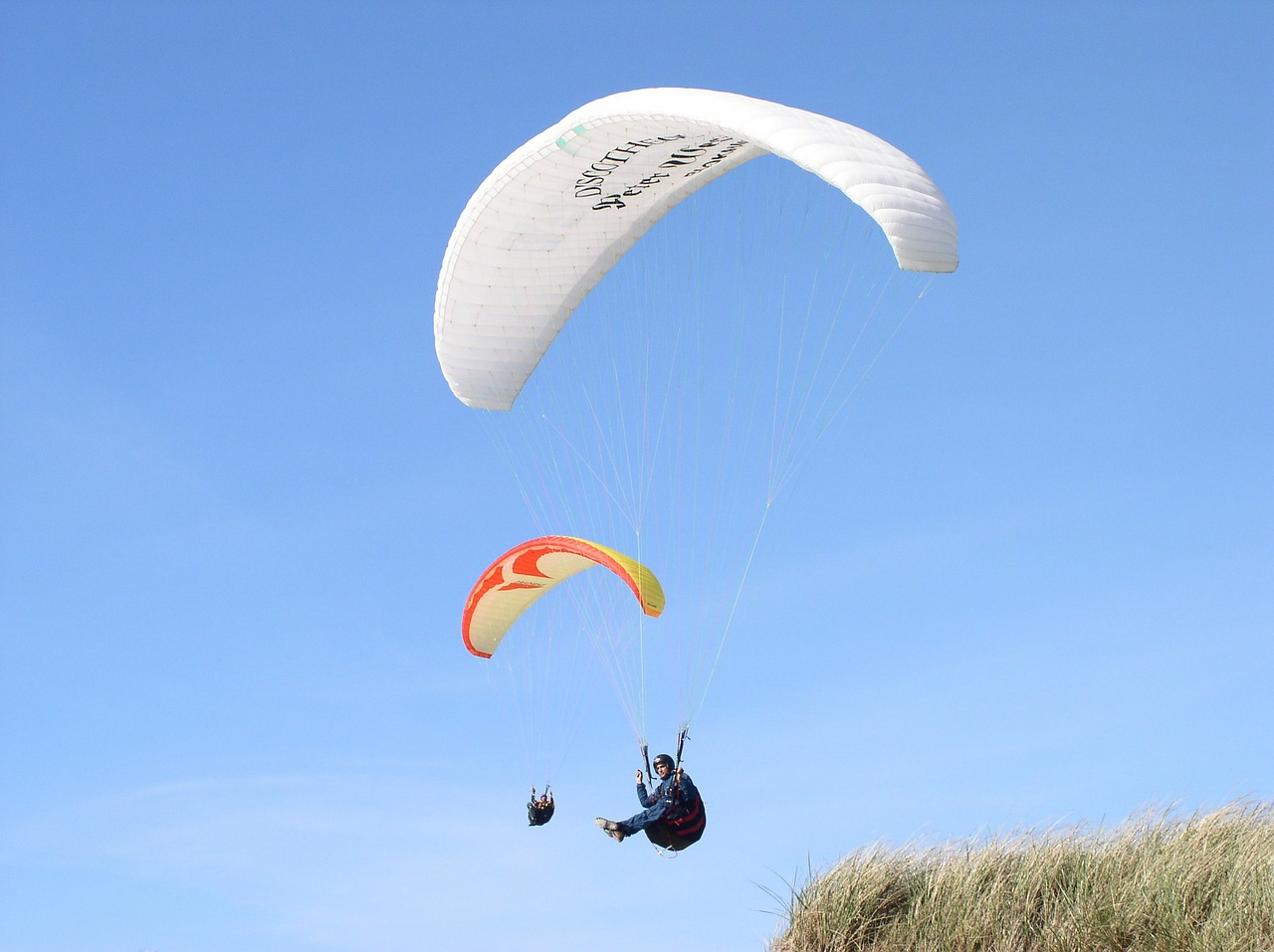 paraglider dune sky free photo