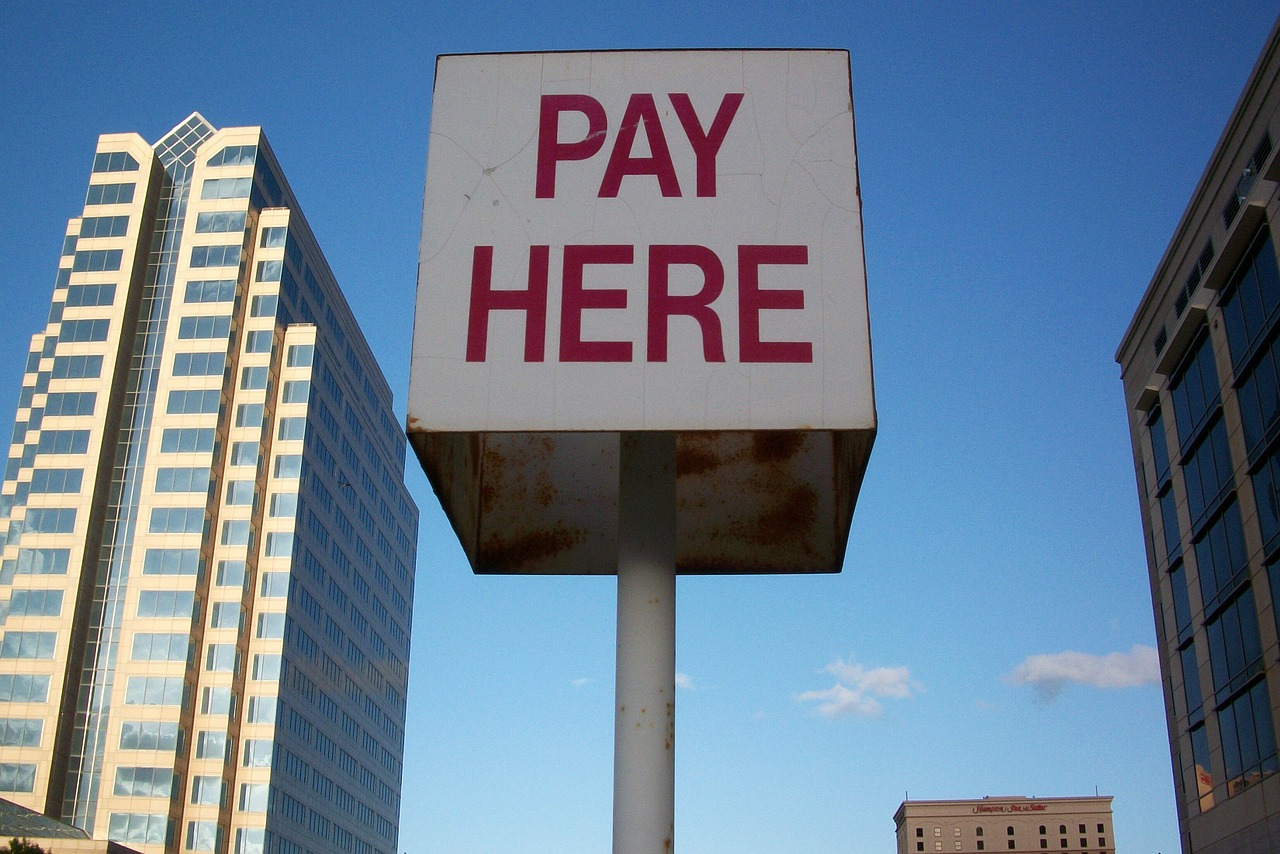 pay here sign texas free photo