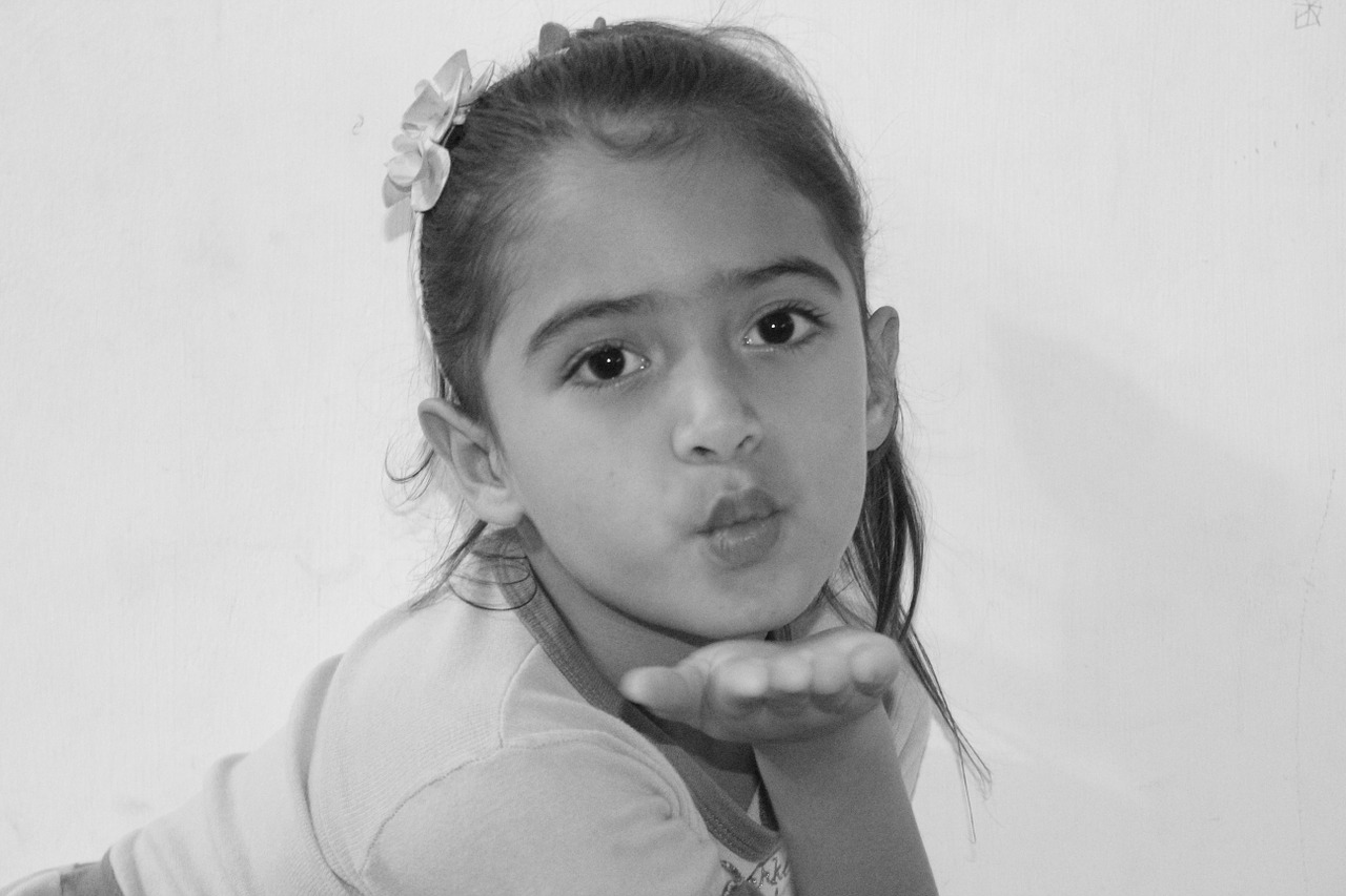peck little girl sending kiss free photo