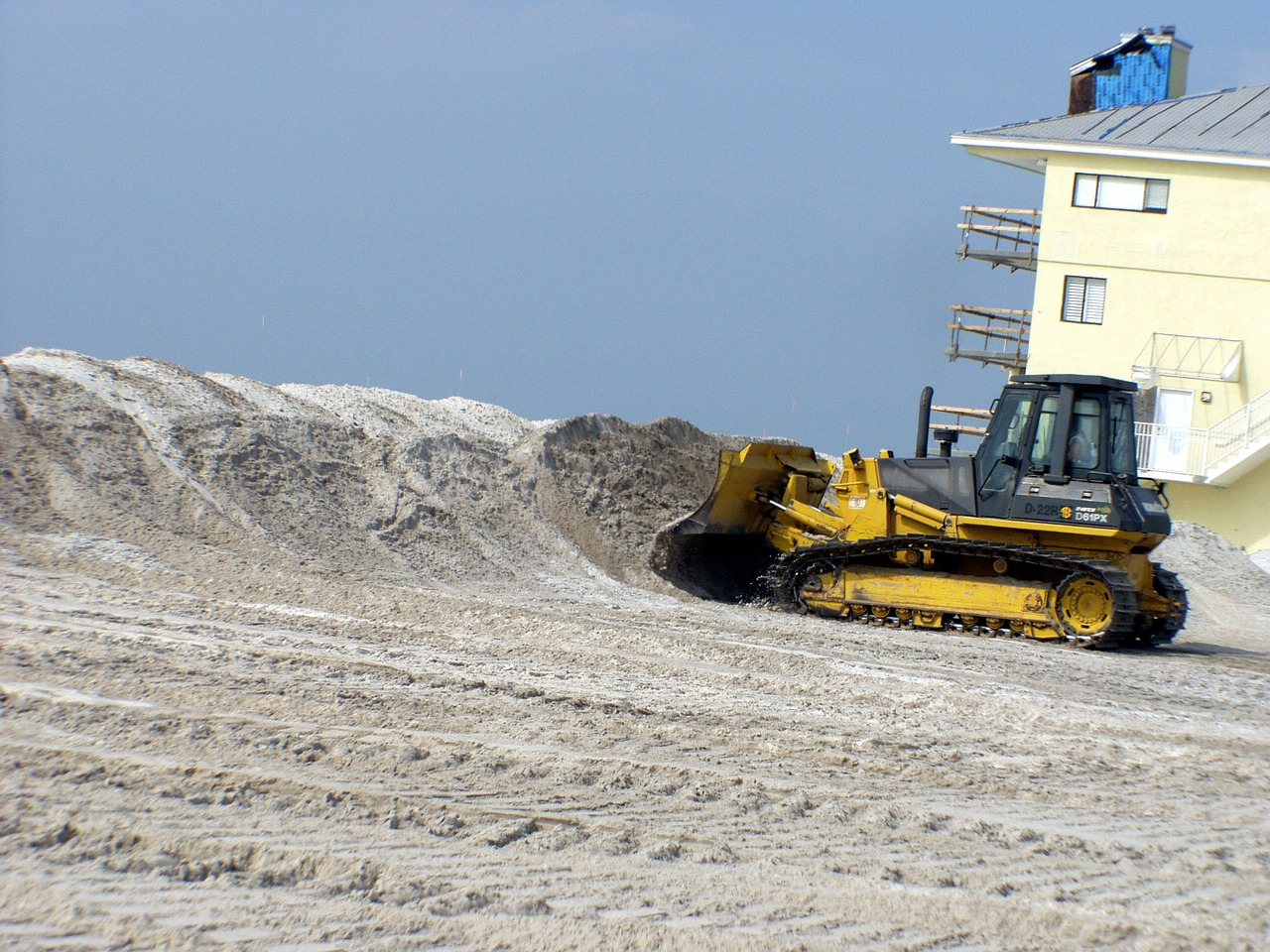 pensacola beach,florida,bulldozer,beach,sand,sky,clouds,hurricane cleanup,nature,outside,sea,ocean,free pictures, free photos, free images, royalty free, free illustrations