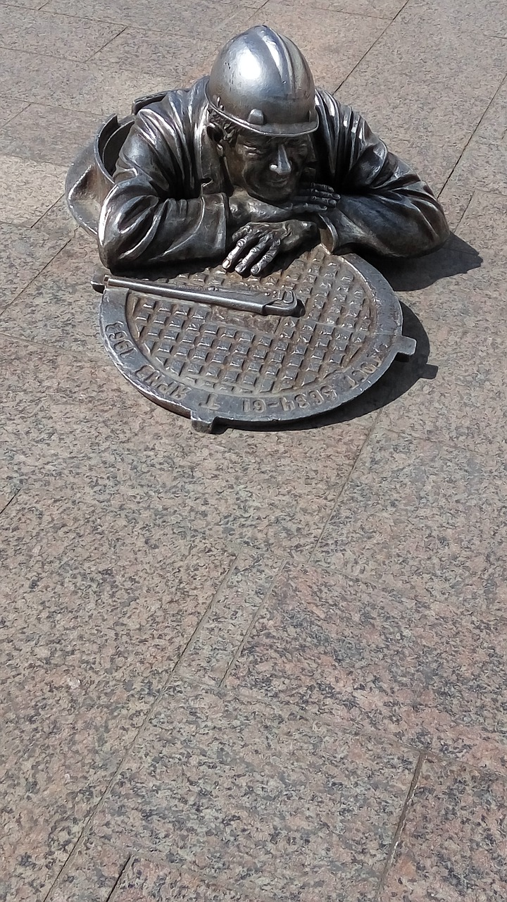 plumber sculpture omsk free photo