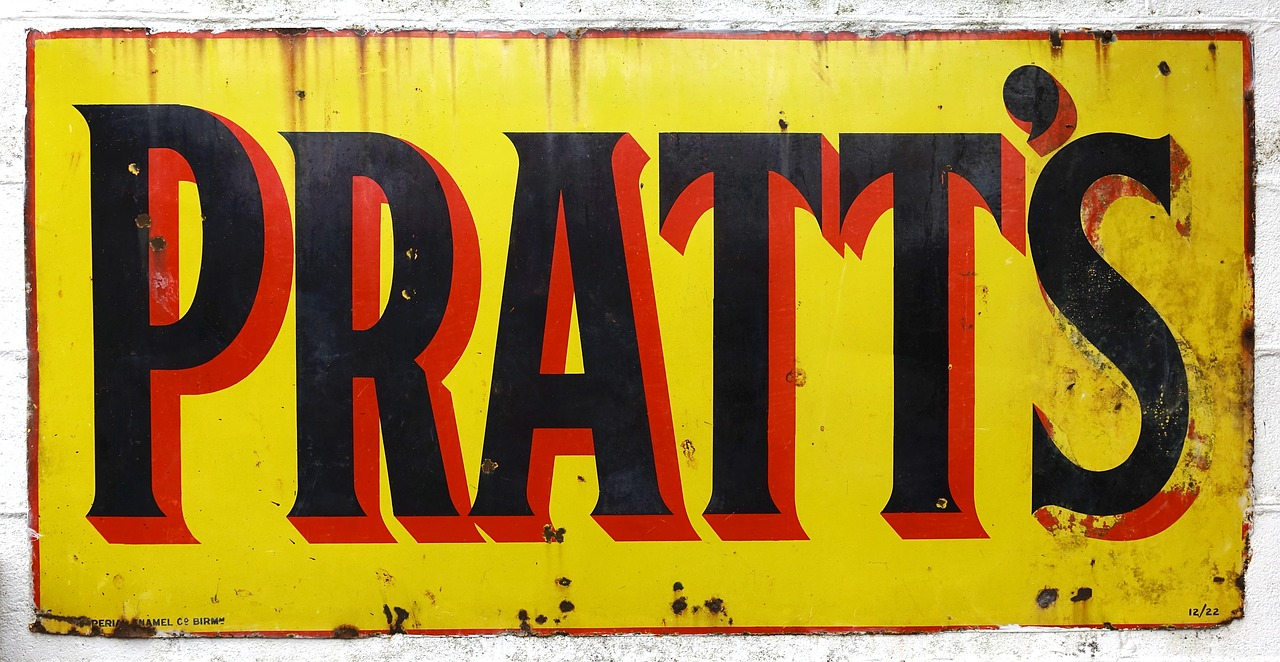 pratts,sign,oil,petrol,petroleum,tin,metal,vintage,rust,rusty,old,gas,gasoline,lubricant,yellow,red,black,advert,advertisement,marketing,promo,advertising,fool,idiot,promotion,free pictures, free photos, free images, royalty free, free illustrations, public domain