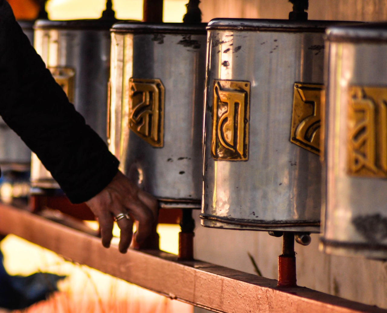 prayer wheels hand prayer free photo