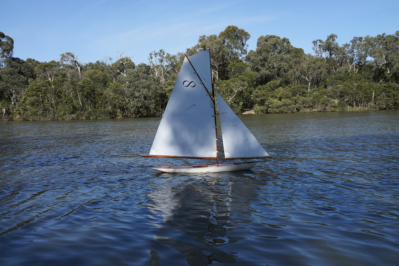 Rc boat,sailing,placid lake,leisure,sailboat - free photo