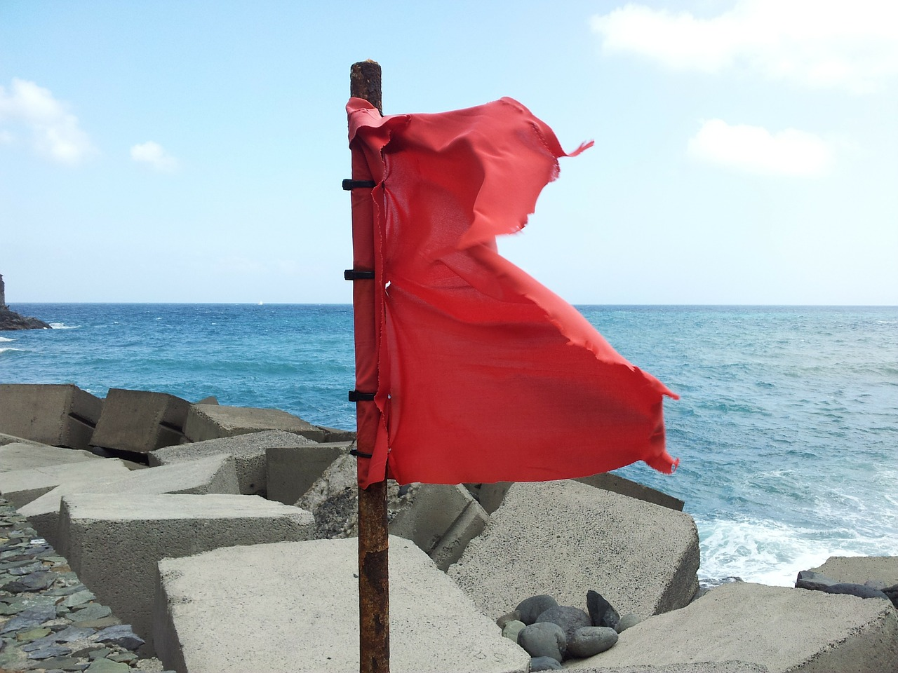 red flag,sea,wind,flag,canary islands,free pictures, free photos, free images, royalty free, free illustrations