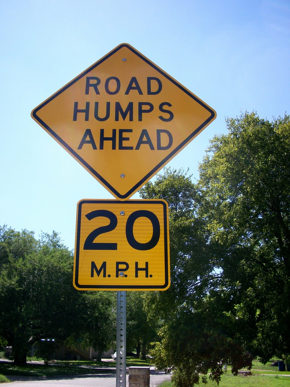 road humps ahead road sign traffic sign free photo