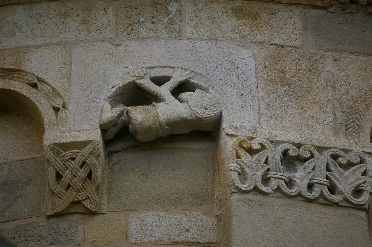 romanesque style sculpture church free photo