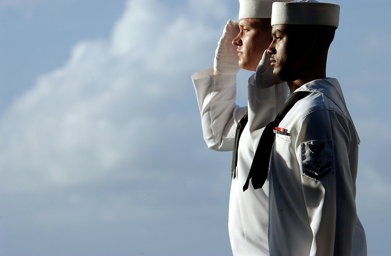sailors saluting isolated free photo