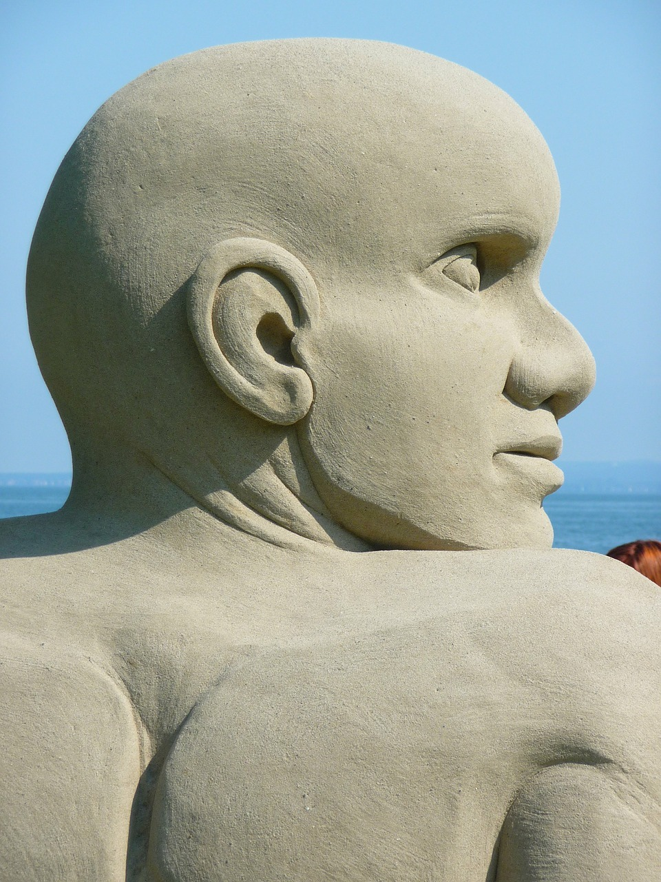 sand sculpture man face free photo
