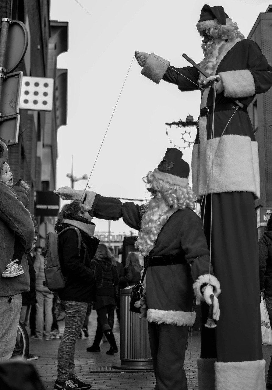 santas marionettes stilts free photo